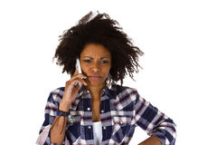 Angry african american woman with cellphone. Isolated on white background Royalty Free Stock Image