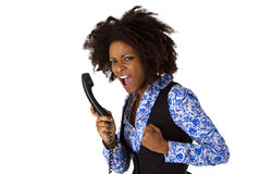 Angry african american woman with handset. Isolated on white background Royalty Free Stock Photos