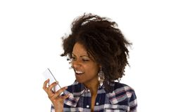 Angry african american woman with handset. Isolated on white background Stock Image