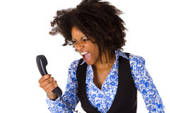 Angry african american woman with handset Royalty Free Stock Photography