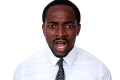 Angry african busienssman screaming Stock Photo