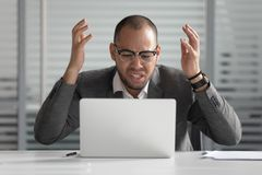 Free Angry African Business Man Using Laptop Mad About Computer Problem Royalty Free Stock Images - 153896549