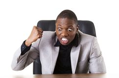 Angry african businessman. Shouting on someone stock images