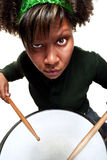 Angry African Girl Playing Drums Stock Photography