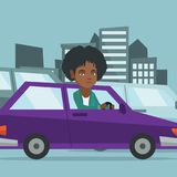 Angry african woman in car stuck in traffic jam. Angry african-american woman in car stuck in a traffic jam. Irritated young woman driving a car in a traffic Stock Photography