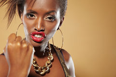 Angry african woman clenching fist. Angry young african woman clenching her fist Stock Photos