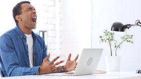 Angry Afro-American Man Screaming Wild at Work Royalty Free Stock Image