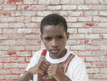 Angry Afro boy, clenched fists, ten years old Royalty Free Stock Photo