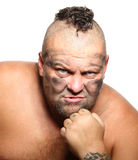 Angry, aggressive, bearded man with mohawk Royalty Free Stock Image
