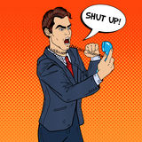 Angry Aggressive Business Man Screaming in Phone. Pop Art royalty free illustration