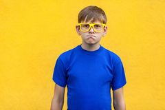 Angry, aggressive concept. Handsome young boy looking at camera Stock Photography