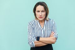 Angry, aggressive. Handsome adult elegant woman looking at camer Royalty Free Stock Photos