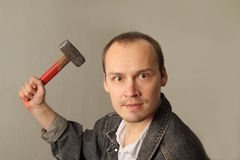 Angry, aggressive man with a big hammer Royalty Free Stock Image