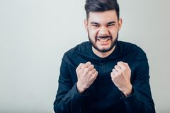 Angry aggressive man shouting out loud with ferocious expression Stock Photos