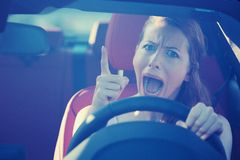 Angry aggressive woman driving car Royalty Free Stock Photography