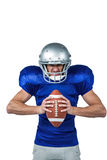 Angry American football player holding ball Royalty Free Stock Photo
