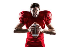 Angry American football player in red jersey holding ball Stock Photography