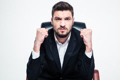 Angry Annoyed Bearded Businessman Sitting And Showing Fists Stock Image