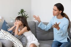 Angry annoyed mom shouting scolding for discipline lecturing stu. Bborn kid ignoring not listening to mother, strict single mum talks to rebellious child royalty free stock images