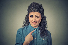 Angry annoyed woman, getting mad asking question you talking to me, mean me? Royalty Free Stock Images