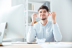 Angry annoyed young businessman working in office Royalty Free Stock Photo