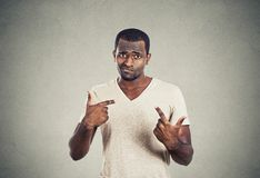 Angry annoyed young man asking you talking to me Stock Photo