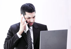 Angry arab business man with tablet and laptop Royalty Free Stock Photos