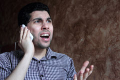 Angry Arab businessman with mobile phone Royalty Free Stock Image