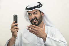 Angry Arabian Businessman, Arabian Businessman expressing anger. On the phone Royalty Free Stock Images
