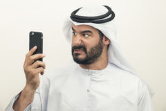 Angry Arabian Businessman, Arabian Businessman expressing anger. On the phone Royalty Free Stock Image