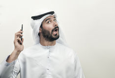 Angry Arabian Businessman, Arabian Businessman expressing anger. On the phone Stock Photo