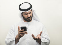 Angry Arabian Businessman, Arabian Businessman expressing anger. On the phone Royalty Free Stock Photography