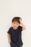 Angry asian boy on white background Royalty Free Stock Photography