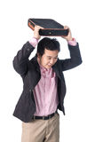 Angry asian businessman throwing briefcase, isolated on white ba Royalty Free Stock Photo