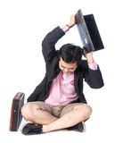 Angry asian businessman throwing laptop, isolated on white backg Stock Image