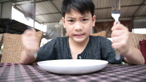 Angry asian child waiting food for launch . stock video footage