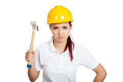 Angry Asian engineer girl hold a hammer Royalty Free Stock Image
