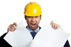 Angry Asian engineer man tear out a blueprint Stock Photography