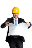 Angry Asian engineer man tearing a plan Stock Photos
