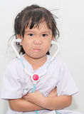 Angry asian girl in doctor costume. Stock Image