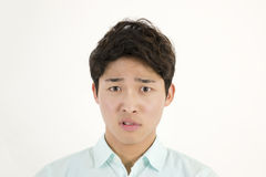 Angry asian male student. Isolated on white background Royalty Free Stock Photos