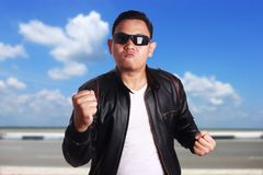 Angry Asian Man in Black Leather Jacket Ready to Fight royalty free stock image