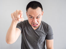 Angry face of asian man portrait. Stock Photography