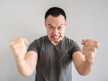 Angry face of asian man portrait. Stock Image