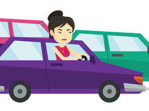 Angry asian woman in car stuck in traffic jam. Royalty Free Stock Image