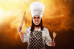 Angry asian woman chef Stock Photography