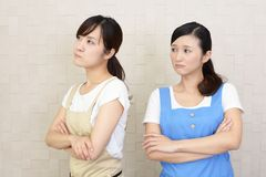 Angry Asian women. In apron royalty free stock image