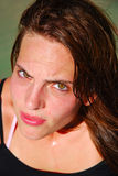 Angry athlete face sweating. An outdoor portrait of a beautiful caucasian white young teenage girl (focus on eyes) with serious facial expression looking up Royalty Free Stock Images