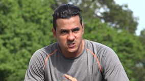 Angry Athletic Hispanic Adult Male. A handsome adult hispanic man stock video footage