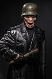 Angry baboonish man in black clothes Royalty Free Stock Photos